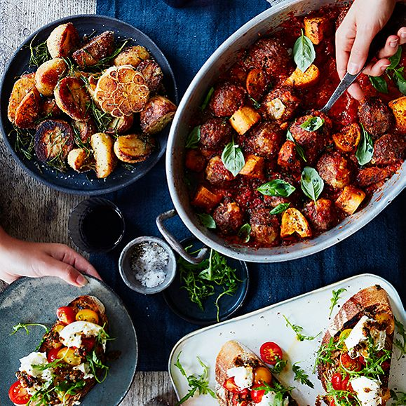A tray of meatballs, roast potatoes and bruschettas