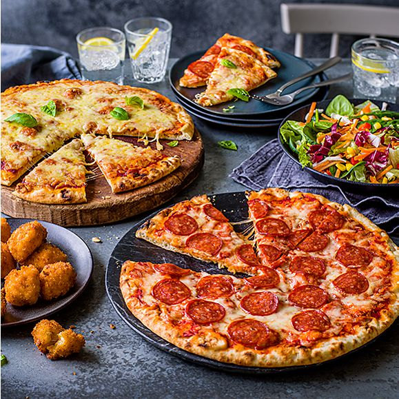 A selection of pizzas and sides