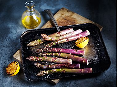 Purple asparagus in a dish