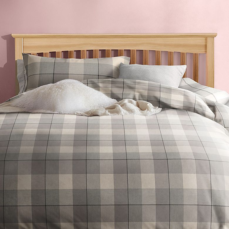 Bed made up with brushed cotton bedding