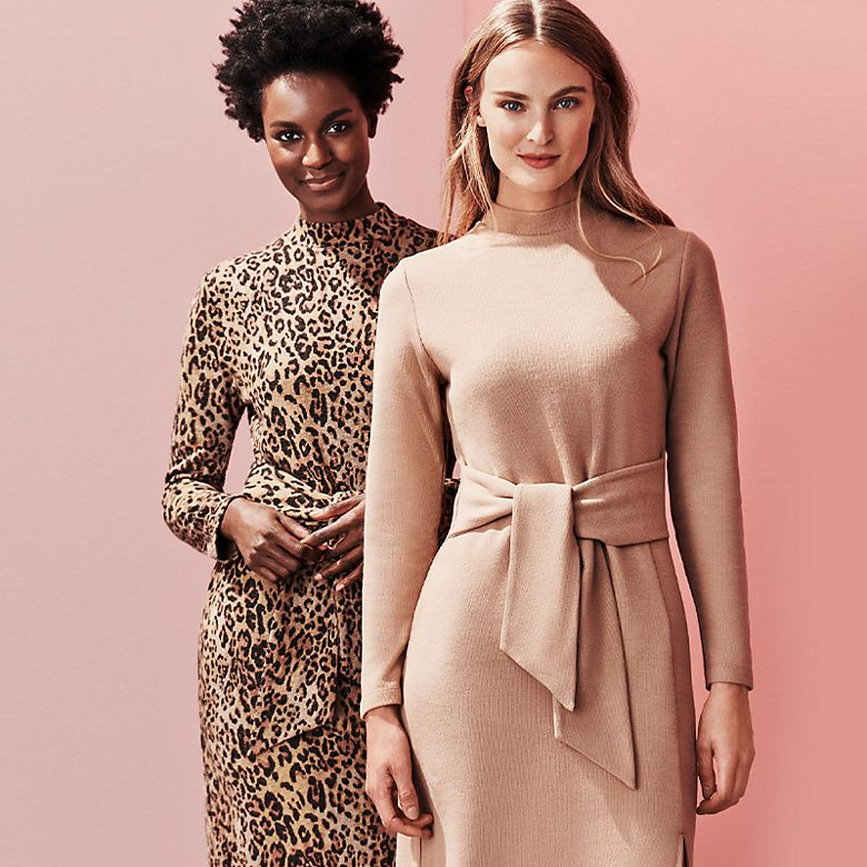 Two women wearing body-con jumper dresses