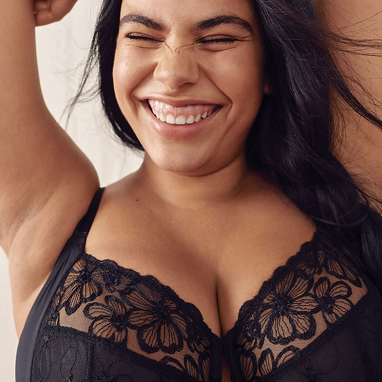 Woman wearing black lace bra for bigger busts
