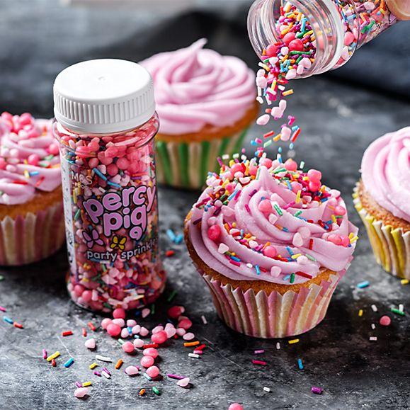 Cupcakes decorated with Percy buttercream and Percy Pig party sprinkles