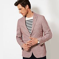 Man wearing pink linen jacket