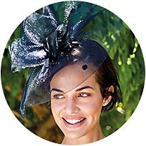 Woman wearing a navy fascinator
