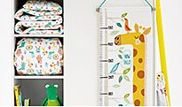 Shelving and height chart in nursery