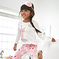 Kid wearing M&S unicorn PJ set