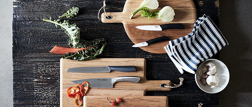 Kitchen knives on wooden chopping boards