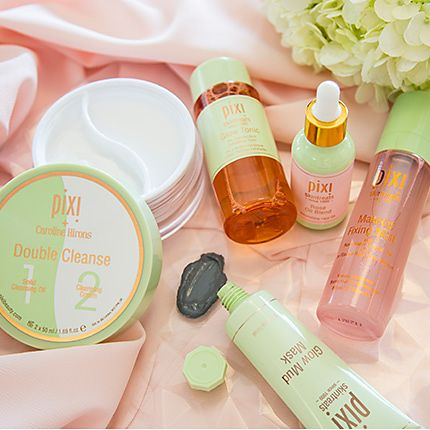 Pixi skincare products on a pretty rose background