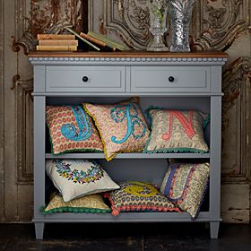 Grey sideboard unit with cushions