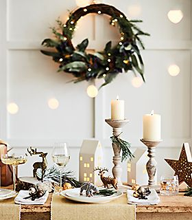 Table laid with candles and Christmas decorations