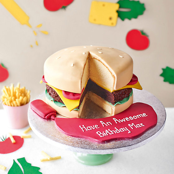 Burger Shaped Sponge And Brownie Cake With Ketchup Icing On A Stand