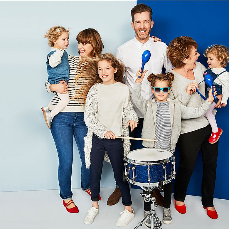 Clemmie and Simon Hooper and family play instruments wearing denim