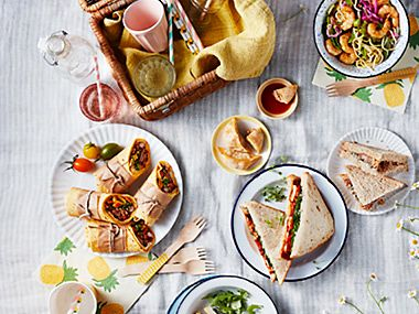 An al fresco spread with salad, wraps and sandwiches