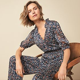 Woman wearing a navy floral-print jumpsuit