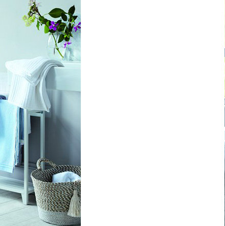 Towels and home fragrance in bathroom