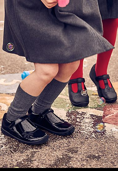 Girls wearing M&S scuff-resistant school shoes