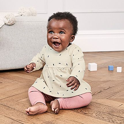 Baby girl wearing a dress from the M&S baby range