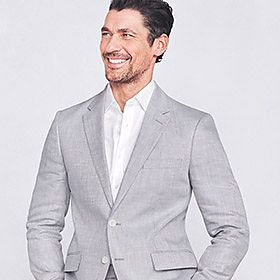 Man wearing pale grey linen suit