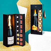 Two bottles of boxed champagne and chocolates