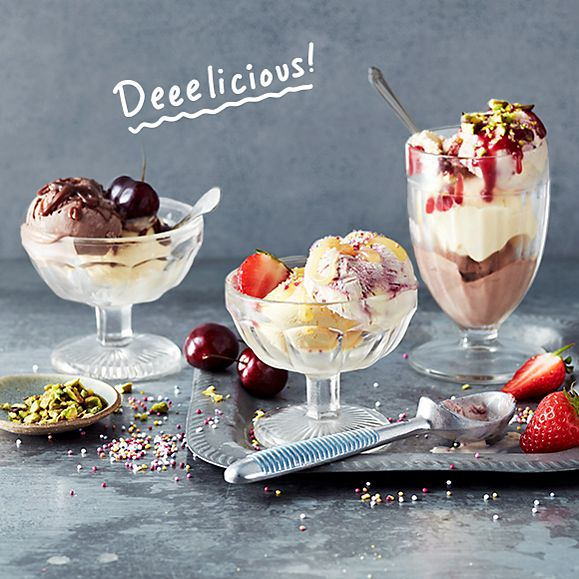 A trio of ice-cream sundaes with fresh fruit, nuts and sauces