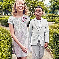 Two kids wearing M&S Celebrate range
