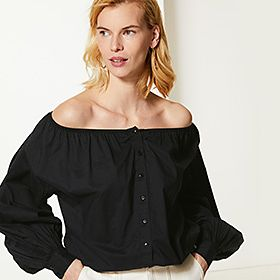 Woman wearing a black off-the-shoulder blouse