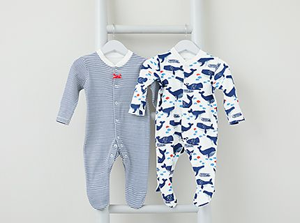 ab9d9878ad6 M S baby sleepsuits hanging on a ladder