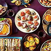 Selection of savoury party food and sandwiches
