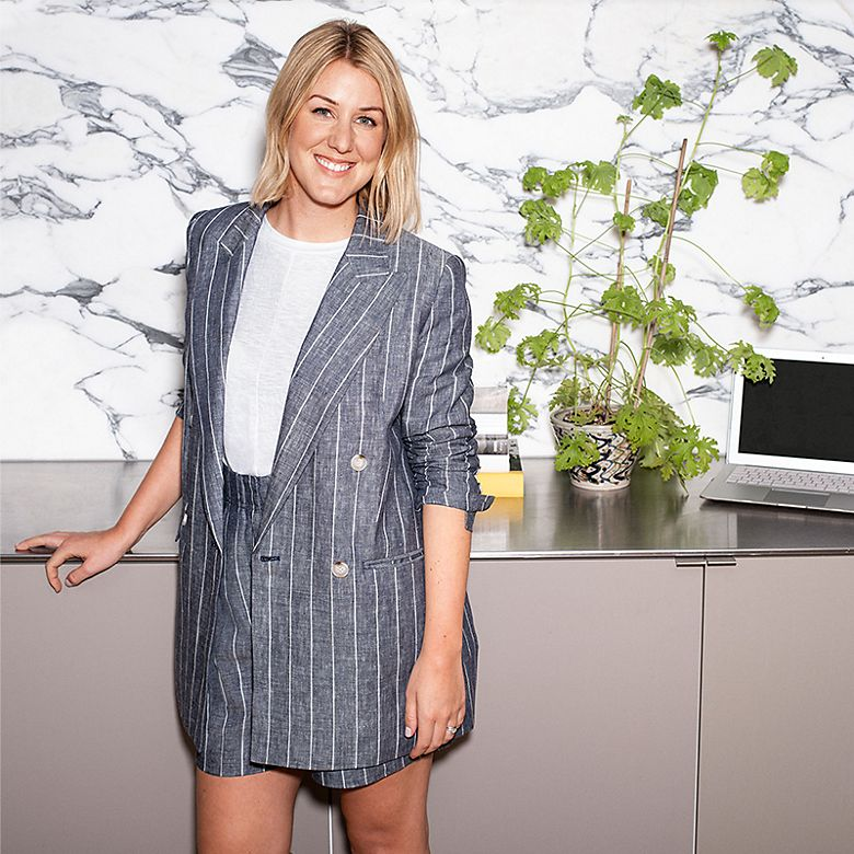 Harriet wearing grey pinstriped linen shorts suit