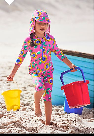 Girl in colourful stay safe UV-protection all-in-one swimsuit