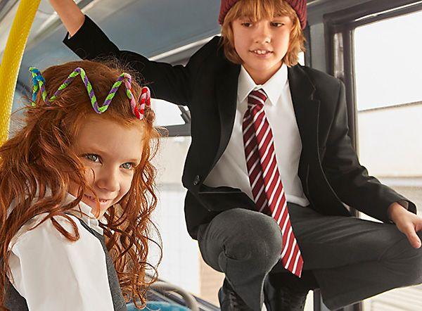 School children on a bus wearing M&S school uniform