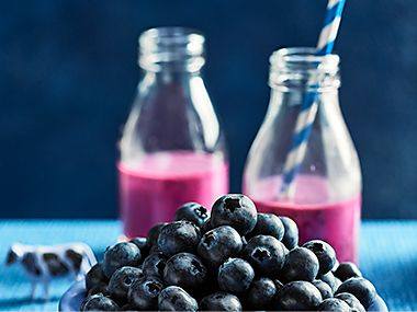 Berry smoothies and a bowl of blueberries
