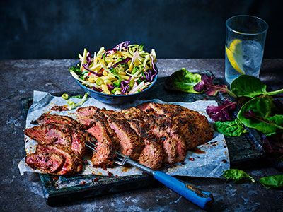 Slices of Korean BBQ steak with a bowl of crunchy salad