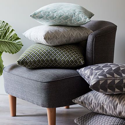 Scatter cushions in different colours on a Kerava armchair