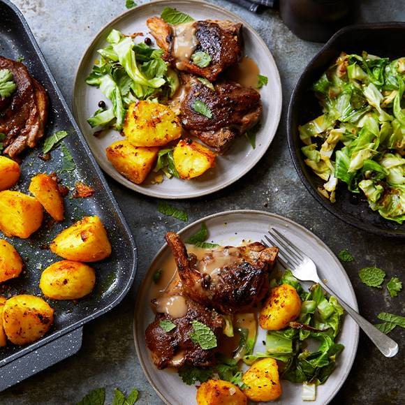 Gingerbread lamb chops with roast potatoes, cabbage and Marsala gravy