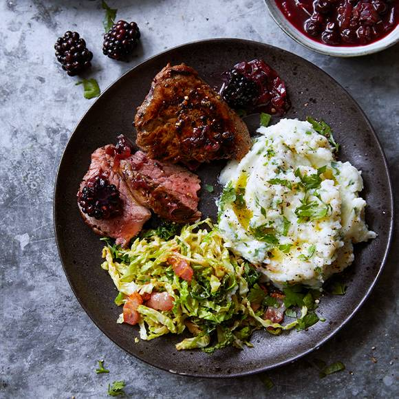Fillet steak and parsley mash with savoy cabbage and smoky bacon