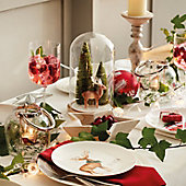 Festive crockery, glassware and candles on a table
