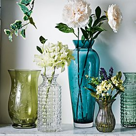 Coloured glass vase and flowers