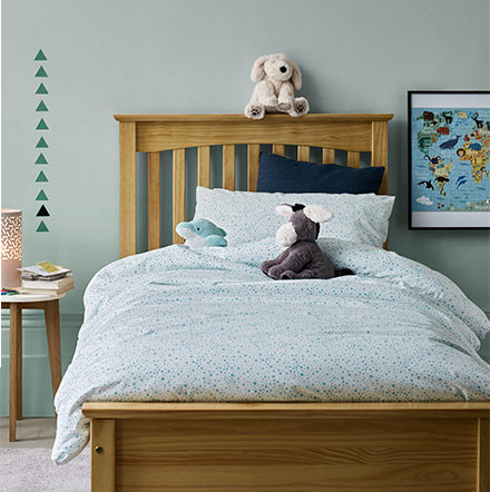 Childrens Bedding In A Kids Bedroom With Wooden Bed