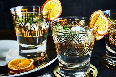 Party drinks including rum with dried orange decoration