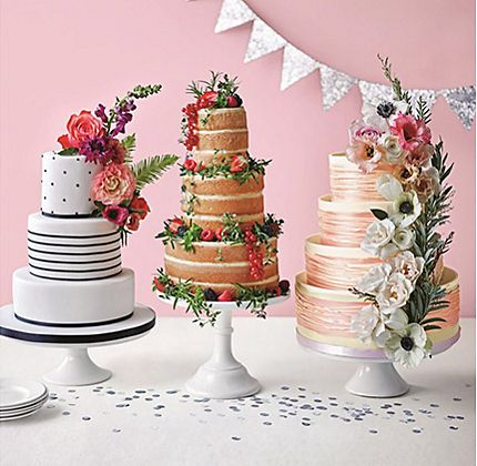 Three wedding cakes on stands