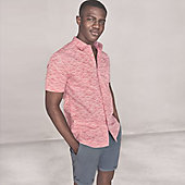 Man wearing blue shorts and pink shirt