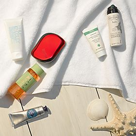 Travel-size toiletries on a wooden deckig setting