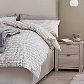 Grey patterned bedding and Arlo bedroom furniture