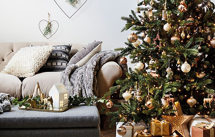 Christmas tree with Christmas decorations and gifts in living room