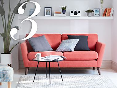 A bright red sofa with cushions