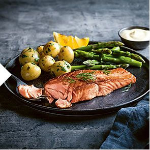 A fillet of salmon with Jersey Royals and asparagus