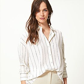 Woman wearing an ivory striped shirt