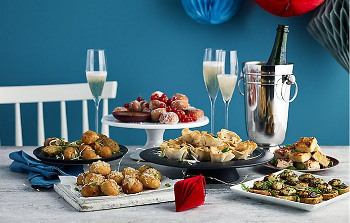 Selection of savoury party food and champagne